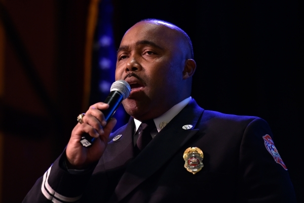 North Las Vegas Fire Captain and Public Information Officer Cedric Williams sings the national anthem before Mayor John Lee's State of the City address at the Texas Station hotel-casino on T ...