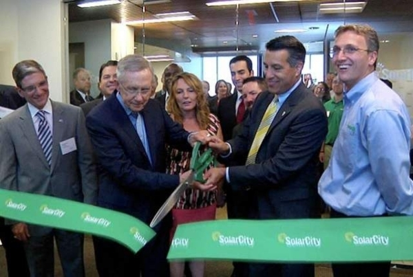 From left, U.S. Rep. Joe Heck, U.S. Sen. Harry Reid and Gov. Brian Sandoval cut the ribbon for the new SolarCity office at Town Square in Aughts 2013. Recently, the Nevada Public Utilities Commiss ...