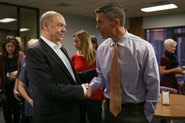 Craig Moon, publisher of the Review-Journal, left, shakes hands with Interim Editor Glenn Cook, after a staff meeting at the newspaper in Las Vegas on Thursday, Jan. 28, 2016. Brett Le Blanc/Las V ...