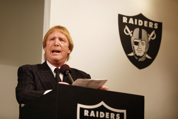 Raiders' owner Mark Davis introduces new head coach Dennis Allen (not pictured) during a news conference at the Raiders' training facility in Oakland, California January 30, 2012.   RE ...