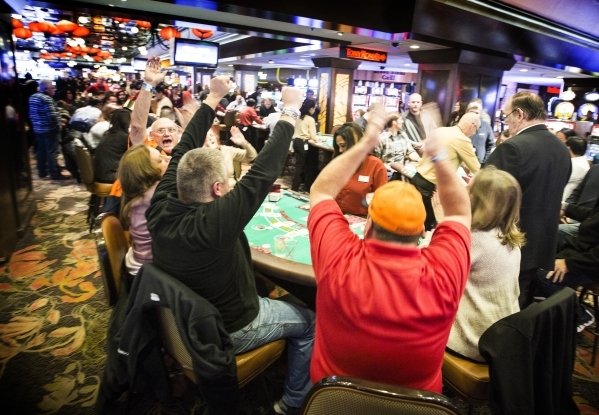 Denver Bronco fans celebrate while winning on a blackjack table in the Fremont hotel-casino on Thursday, Dec.. 31, 2015.  Jeff Scheid/ Las Vegas Review-Journal Follow @jlscheid