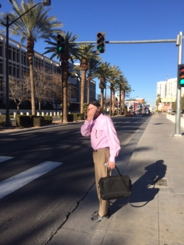 William Hatley tries to hide his face after leaving the Lloyd George U.S. Courthouse on Thursday, July 28, 2015. Jeff German/Las Vegas Review-Journal
