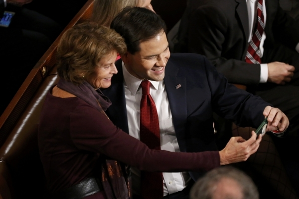 Republican U.S. presidential candidate Senator Marco Rubio (R) takes a selfie with U.S. Senator Lisa Murkowski (L) as they wait for U.S. President Barack Obama's State of the Union address t ...