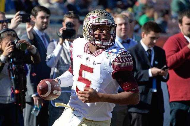 Jan 1, 2015; Pasadena, CA, USA; Florida State Seminoles quarterback Jameis Winston (5) warms up prior to the 2015 Rose Bowl college football game at Rose Bowl. (Robert Hanashiro/USA Today Sports)