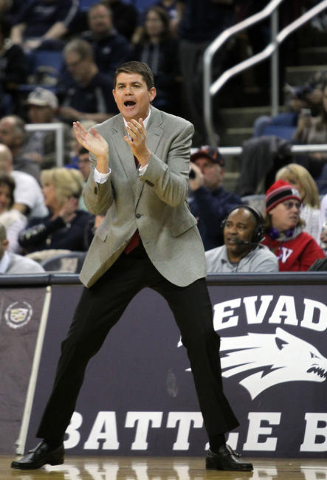 Runnin' Rebel head coach Dave Rice calls in a play during the first half of their NCAA basketball game with the Nevada Wolf Pack at Lawlor Events Center. Mandatory Credit: Lance Iversen-USA TODA ...
