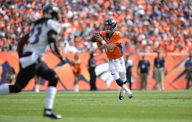 Sep 13, 2015; Denver, CO, USA; Denver Broncos quarterback Peyton Manning (18) runs a play in the first quarter against the Baltimore Ravens at Sports Authority Field at Mile High. (Ron Chenoy/USA  ...