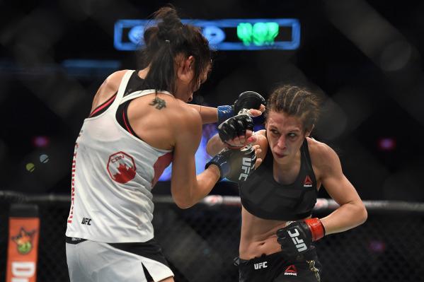 Nov 15, 2015; Melbourne, Australia; Joanna Jedrzejczyk (red gloves) competes against Valerie Letourneau (blue gloves) during UFC 193 at Etihad Stadium. (Matt Roberts/USA Today Sports)