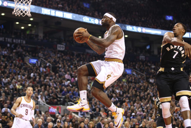 Nov 25, 2015; Toronto, Ontario, CAN; Cleveland Cavaliers forward LeBron James (23) scores against the Toronto Raptors at Air Canada Centre. The Raptors beat the Cavaliers 103-99. (Tom Szczerbowski ...
