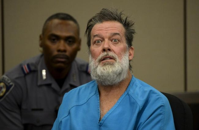 Robert Lewis Dear, 57, accused of shooting three people to death and wounding nine others at a Planned Parenthood clinic in Colorado last month, attends his hearing to face 179 counts of various c ...