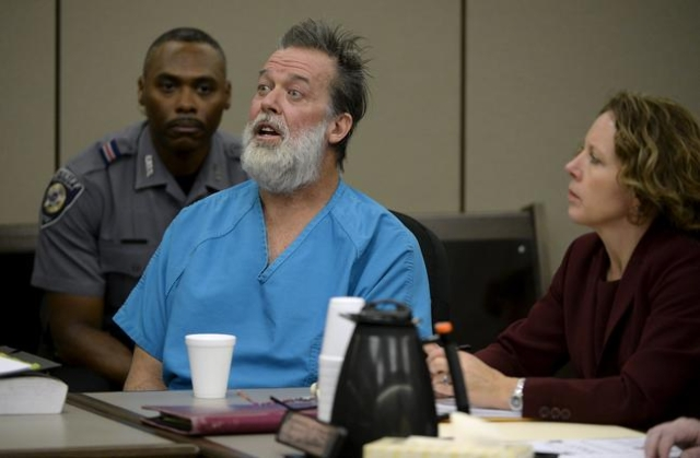Robert Lewis Dear, 57, accused of shooting three people to death and wounding nine others at a Planned Parenthood clinic in Colorado last month, makes an outburst during his hearing to face 179 co ...