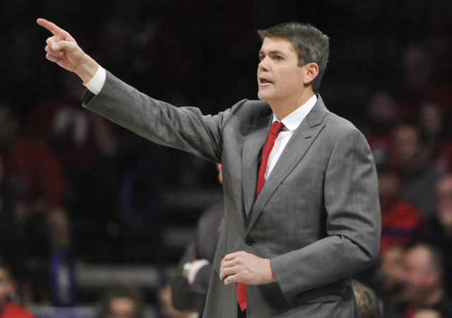 UNLV Rebels head coach Dave Rice signals during the second half against the Arizona Wildcats at McKale Center. Arizona won 82-70. Mandatory Credit: Casey Sapio-USA TODAY Sports