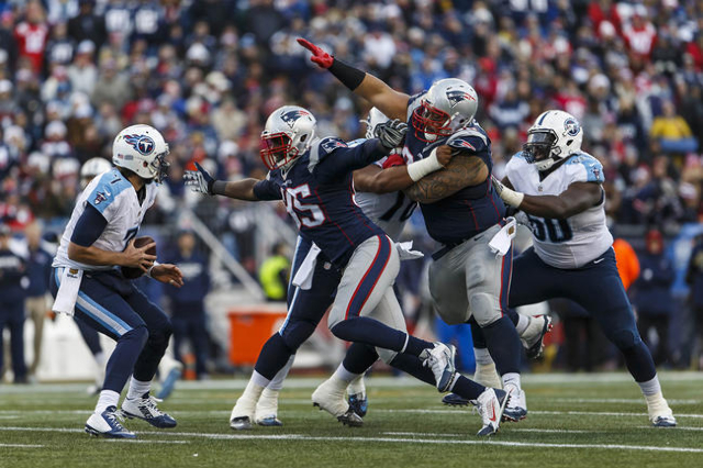 Dec 20, 2015; Foxborough, MA, USA; New England Patriots defensive end Chandler Jones (95) sacks Tennessee Titans quarterback Zach Mettenberger (7) in the second half at Gillette Stadium. The Patri ...