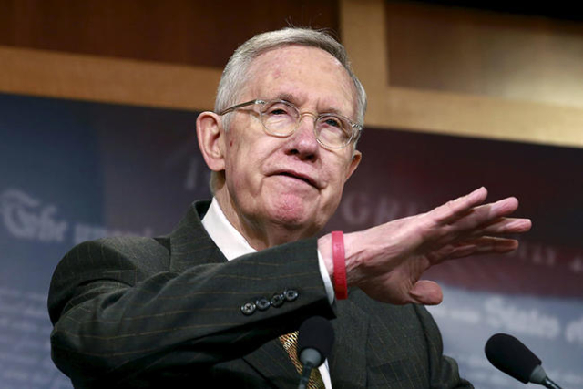 U.S. Senate Minority Leader Harry Reid (D-NV) speaks at a news conference to discuss the omnibus/tax extenders legislation and the first year of the 114th Congress on Capitol Hill in Washington, D ...