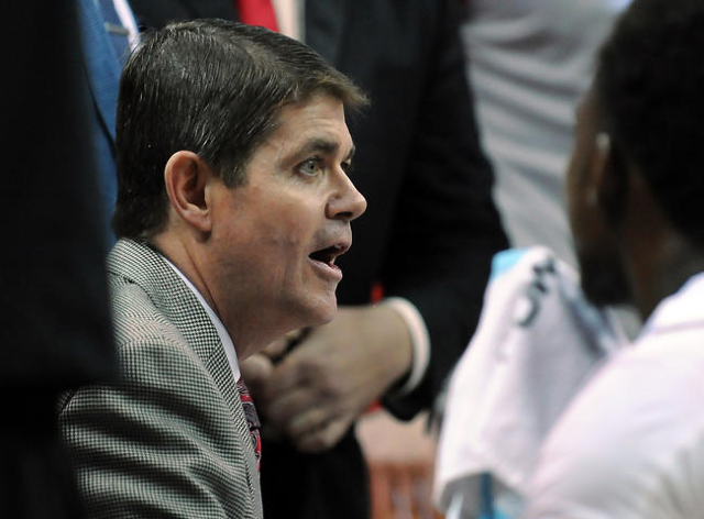 UNLV Runnin' Rebels head coach Dave Rice talks to a player in a huddle during a game against South Dakota at Thomas & Mack Center. UNLV won the game 103-68. Mandatory Credit: Stephen R.  ...
