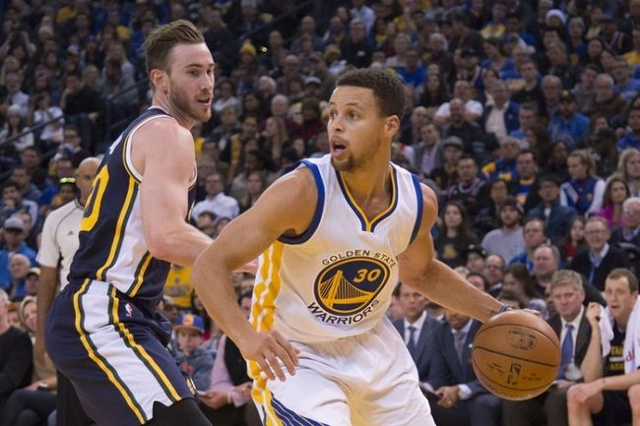 Golden State Warriors guard Stephen Curry (30) dribbles the basketball against Utah Jazz forward Gordon Hayward (20, left) during the second quarter at Oracle Arena. (Reuters/Kyle Terada-USA TODAY ...