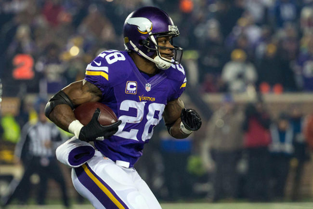 Dec 27, 2015; Minneapolis, MN, USA; Minnesota Vikings running back Adrian Peterson (28) carries the ball during the first quarter against the New York Giants at TCF Bank Stadium. (Brace Hemmelgarn ...