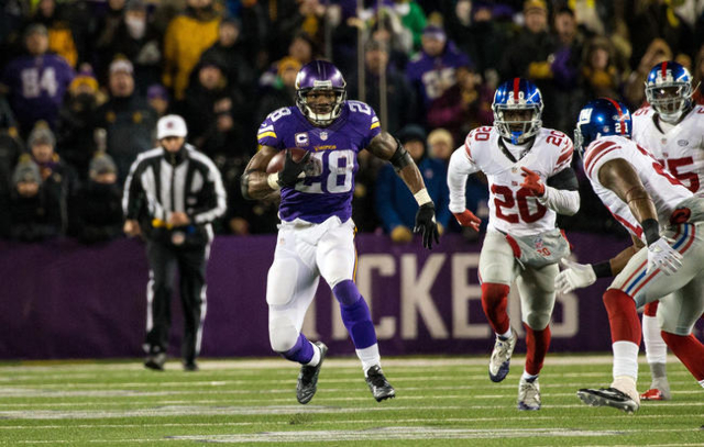 Dec 27, 2015; Minneapolis, MN, USA; Minnesota Vikings running back Adrian Peterson (28) carries the ball during the third quarter against the New York Giants at TCF Bank Stadium. The Vikings defea ...