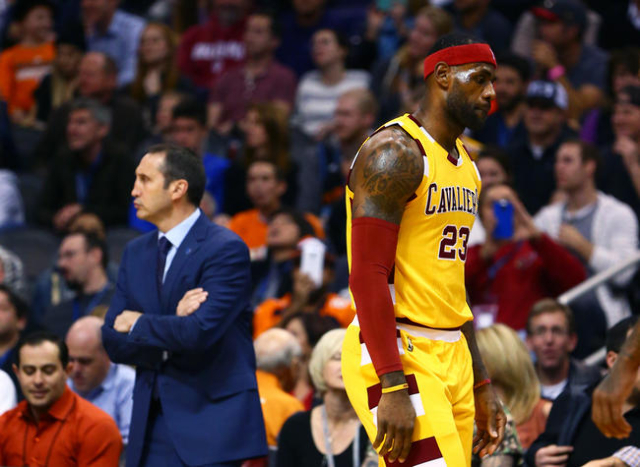 Dec 28, 2015; Phoenix, AZ, USA; Cleveland Cavaliers forward LeBron James walks past head coach David Blatt against the Phoenix Suns at Talking Stick Resort Arena. The Cavaliers defeated the Suns 1 ...