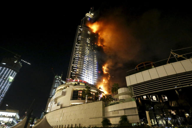 A fire engulfs The Address Hotel in downtown Dubai in the United Arab Emirates December 31, 2015. (Ahmed Jadallah/Reuters)