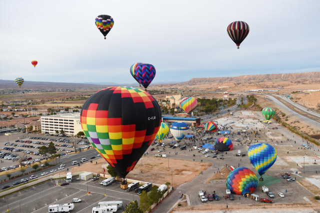 Balloons lift off from a parking lot across from the CasaBlanca Resort during the annual Hot Air Balloon Festival Saturday, Jan. 23, 2016, in Mesquite, Nev. The festival, about 80 miles north of L ...
