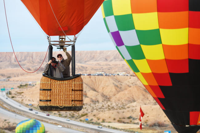 Balloons float over Interstate 15 during the annual Hot Air Balloon Festival Saturday, Jan. 23, 2016, in Mesquite, Nev. The festival, about 80 miles north of Las Vegas, continues through Sunday, J ...