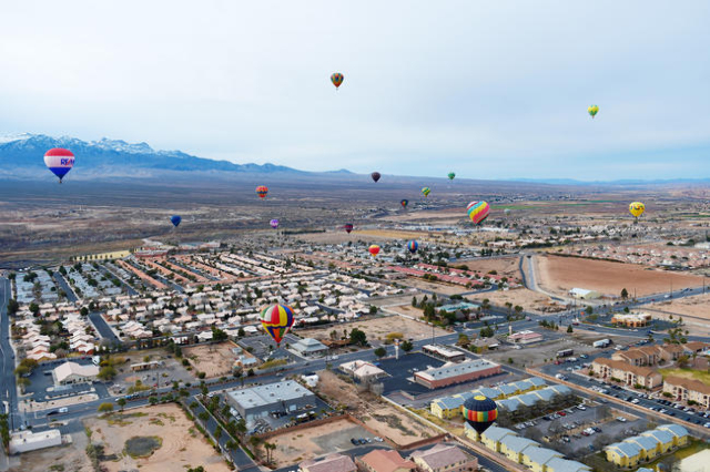 Hot air balloons float over Mesquite, Nev., during the annual Hot Air Balloon Festival Saturday, Jan. 23, 2016. The festival, about 80 miles north of Las Vegas, continues through Sunday, Jan. 24th ...
