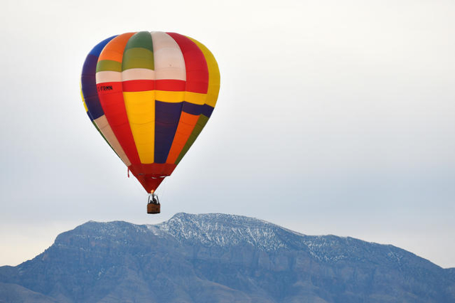 A hot air balloon drifts over Mesquite, Nev., during the annual Hot Air Balloon Festival Saturday, Jan. 23, 2016. The festival, about 80 miles north of Las Vegas, continues through Sunday, Jan. 24 ...