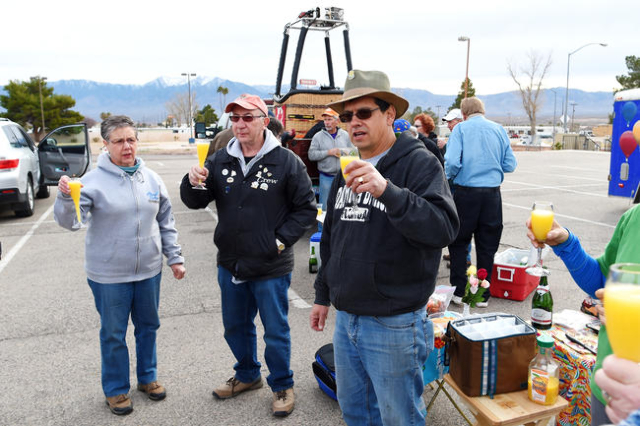 Cliff Skodopole offer up a traditional champagne, and in this case, mimosa, toast after a ride during the annual Hot Air Balloon Festival Saturday, Jan. 23, 2016, in Mesquite, Nev. The festival, a ...