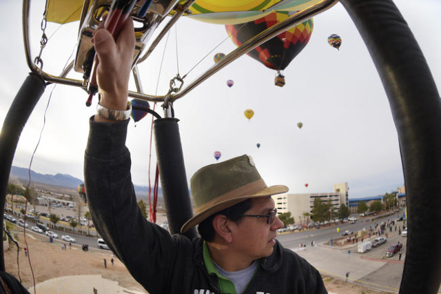 """Cliff Skocdopole pilots his balloon """"Mr. Smee"""" during the annual Hot Air Balloon Festival Saturday, Jan. 23, 2016, in Mesquite, Nev. The festival, about 80 miles north of Las Vegas, cont ..."""