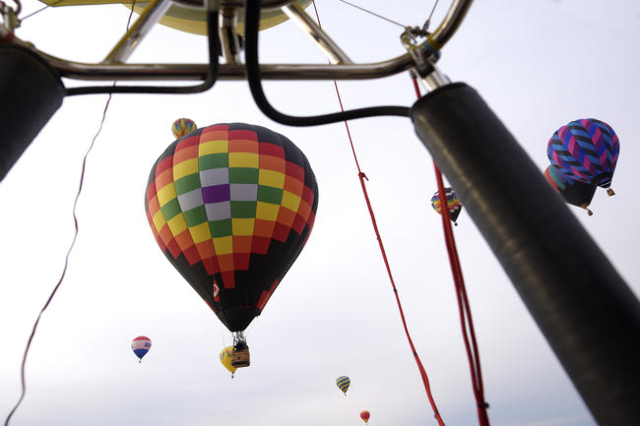 Balloons float over Mesquite, Nev., during the annual Hot Air Balloon Festival Saturday, Jan. 23, 2016. The festival, about 80 miles north of Las Vegas, continues through Sunday, Jan. 24th. (Sam M ...