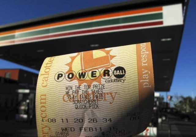 A powerball Lottery ticket is shown in this photo illustration after being purchased at a gas station in San Diego in 2015. (REUTERS/Mike Blake)