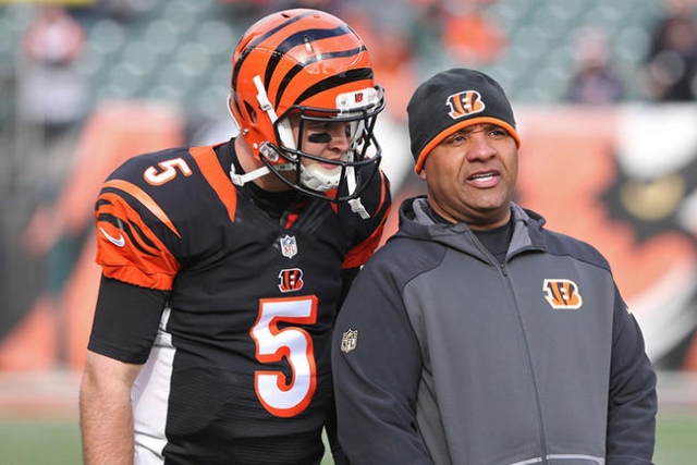 Jan 3, 2016; Cincinnati, OH, USA; Cincinnati Bengals quarterback AJ McCarron (5) talks with offensive coordinator Hue Jackson (R) during warmups prior to the game against the Baltimore Ravens at P ...