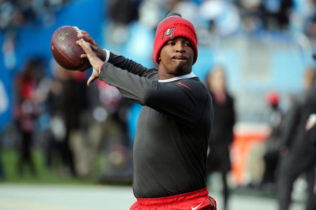 Jan 3, 2016; Charlotte, NC, USA; Tampa Bay Buccaneers quarterback Jameis Winston (3) passes the ball during the warm ups prior to the game against the Carolina Panthers at Bank of America Stadium. ...