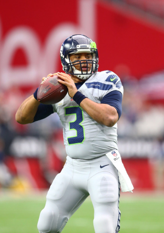 Jan 3, 2016; Glendale, AZ, USA; Seattle Seahawks quarterback Russell Wilson warms up prior to the game against the Arizona Cardinals at University of Phoenix Stadium. Mandatory Credit: Mark J. Reb ...