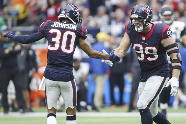 Jan 3, 2016; Houston, TX, USA; Houston Texans defensive end J.J. Watt (99) celebrates with strong safety Kevin Johnson (30) after a sack during the third quarter against the Jacksonville Jaguars a ...