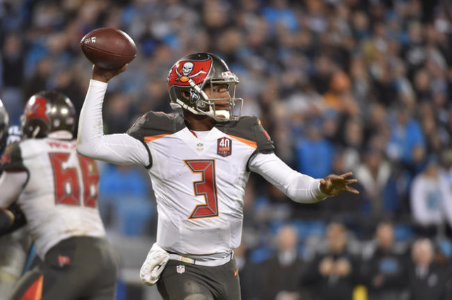 Jan 3, 2016; Charlotte, NC, USA; Tampa Bay Buccaneers quarterback Jameis Winston (3) looks to pass in the third quarter. The Panthers defeated the Buccaneers 31-10 at Bank of America Stadium. (Bob ...