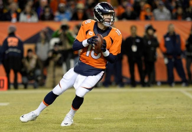 Denver Broncos quarterback Peyton Manning (18) drops back to pass the football in the fourth quarter against the San Diego Chargers at Sports Authority Field at Mile High. The Broncos defeated the ...