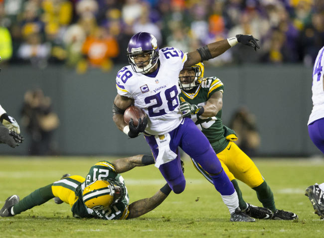 Jan 3, 2016; Green Bay, WI, USA; Minnesota Vikings running back Adrian Peterson (28) rushes with the football during the third quarter against the Green Bay Packers at Lambeau Field.  Minnesota wo ...