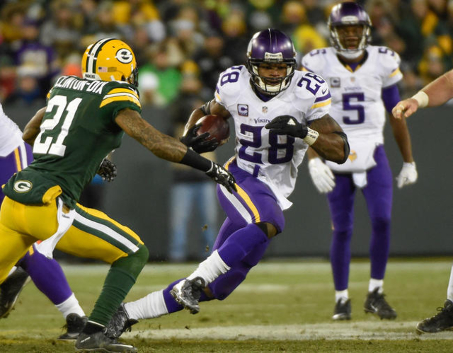 Jan 3, 2016; Green Bay, WI, USA;  Minnesota Vikings running back Adrian Peterson (28) tries to run past Green Bay Packers safety Ha Ha Clinton-Dix (21) in the third quarter at Lambeau Field. (Benn ...