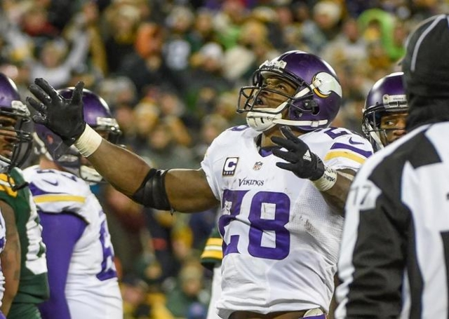 Jan 3, 2016; Green Bay, WI, USA;  Minnesota Vikings running back Adrian Peterson (28) reacts after scoring a touchdown in the third quarter during the game against the Green Bay Packers at Lambeau ...