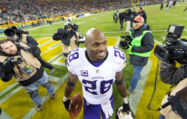Jan 3, 2016; Green Bay, WI, USA; Minnesota Vikings running back Adrian Peterson (28) walks from the field following the game against the Green Bay Packers at Lambeau Field.  Minnesota won 20-13. ( ...