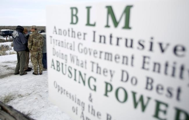 Militiamen stand on a road at the Malheur National Wildlife Refuge near Burns, Oregon, January 4, 2016. The leaders of a group of self-styled militiamen who took over a U.S. wildlife refuge headqu ...