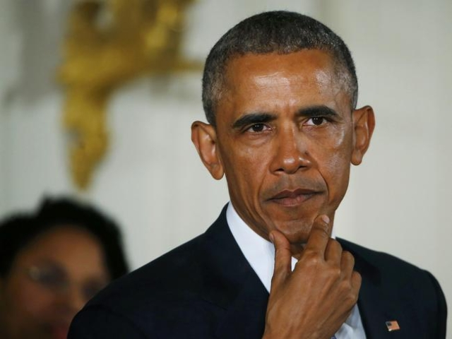 President Barack Obama pauses while delivering a statement on steps the administration is taking to reduce gun violence in the East Room of the White House in Washington January 5, 2016. (Carlos B ...