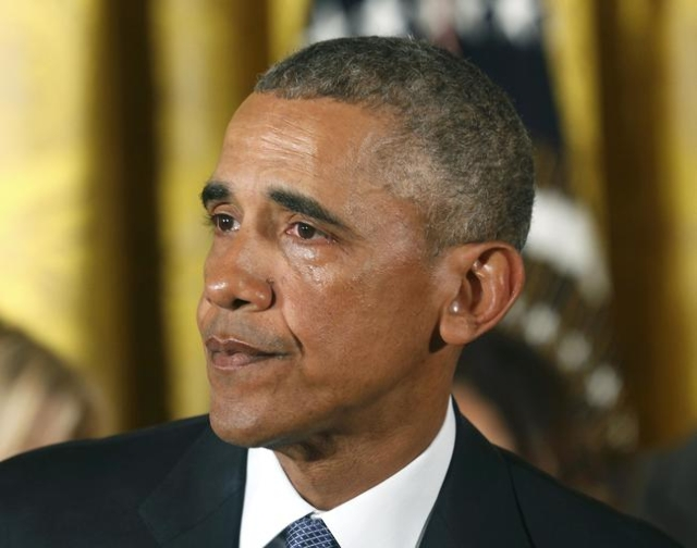 U.S. President Barack Obama sheds a tear while announcing steps the administration is taking to reduce gun violence while delivering a statement in the East Room of the White House in Washington J ...