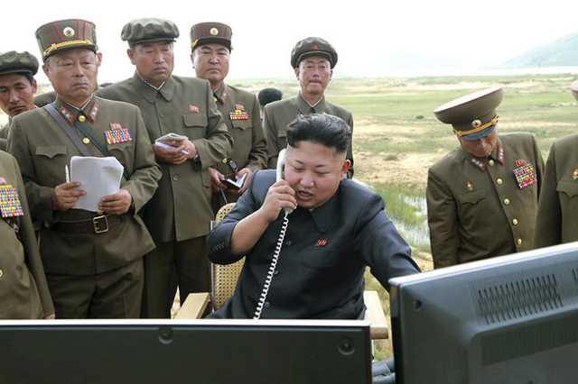 North Korean leader Kim Jung Un guides the test fire of a tactical rocket in this undated photo released by North Korea's Korean Central News Agency (KCNA) in Pyongyang August 15, 2014.  REU ...
