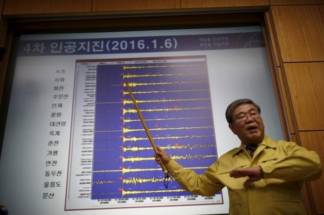 Ko Yun-hwa, Administrator of Korea Meteorological Administration, points to a chart showing seismic waves observed in South Korea, during a media briefing at Korea Meteorological Administration in ...