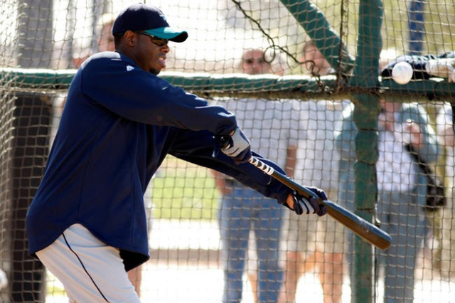 Ken Griffey Jr. bunts the ball during spring training camp in 2010. (Rick Scuteri/Reuters)