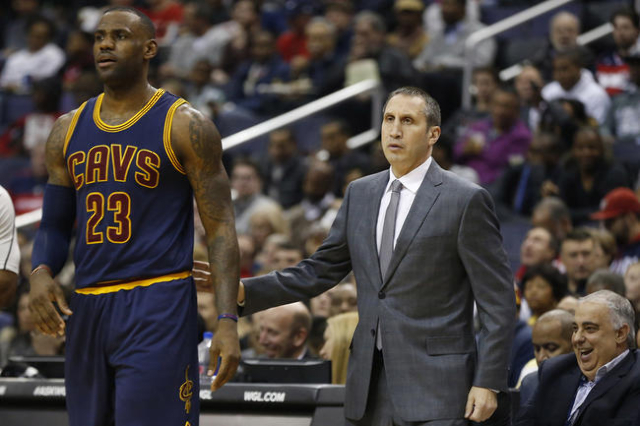 Jan 6, 2016; Washington, DC, USA; Cleveland Cavaliers forward LeBron James (23) stands with Cavaliers head coach David Blatt (R) against the Washington Wizards in the second quarter at Verizon Cen ...