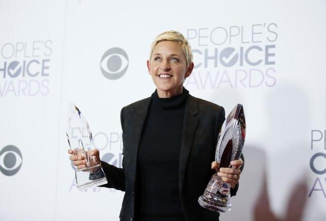 Ellen DeGeneres poses backstage with her Humanitarian Award and Award for Favorite Daytime TV Host during the People's Choice Awards 2016 in Los Angeles, Jan. 6, 2016.  (Danny Moloshok/Reuters)