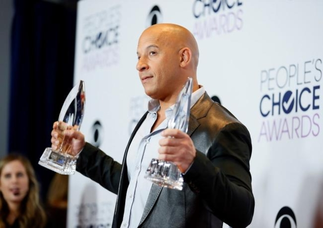 "Actor Vin Diesel poses backstage with the awards for Favorite Movie and Favorite Action Movie for ""Furious 7"" during the People's Choice Awards 2016 in Los Angeles, Jan. 6, 2016.   ..."